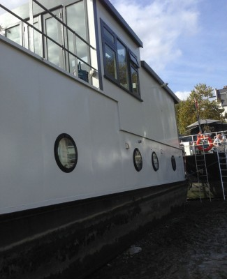 Finished exterior painting of houseboat, Chelsea Boatyard