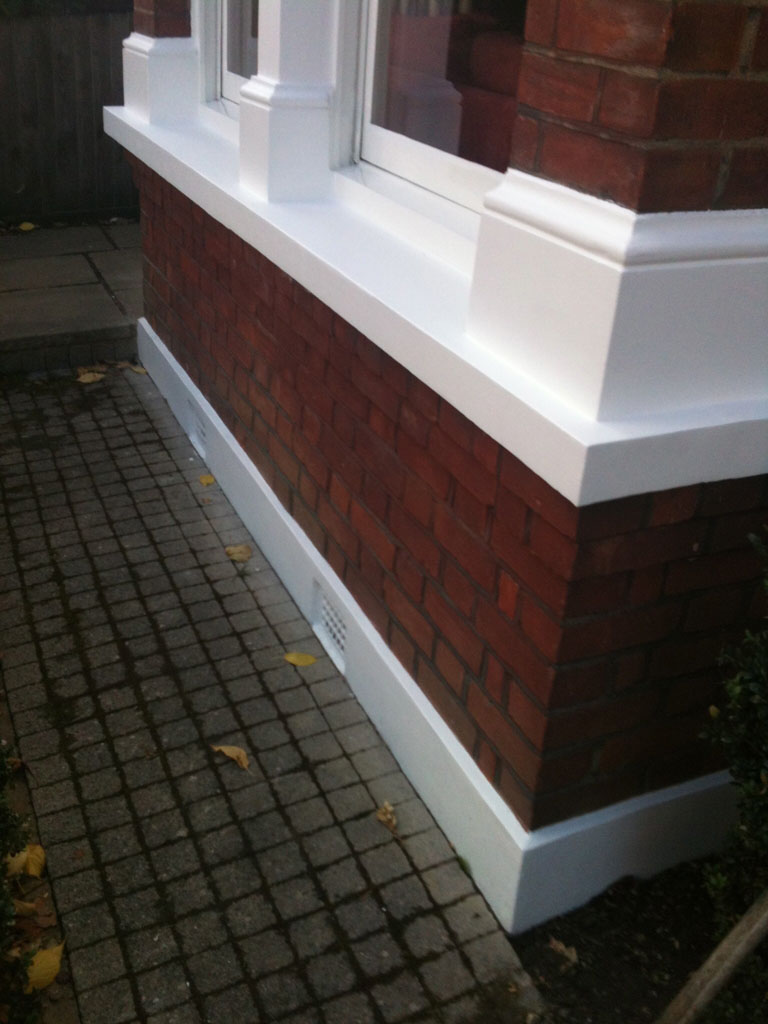 Exterior painting of window sill finished