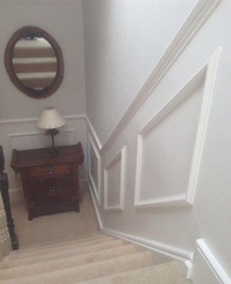 New paneling on staircase after painting