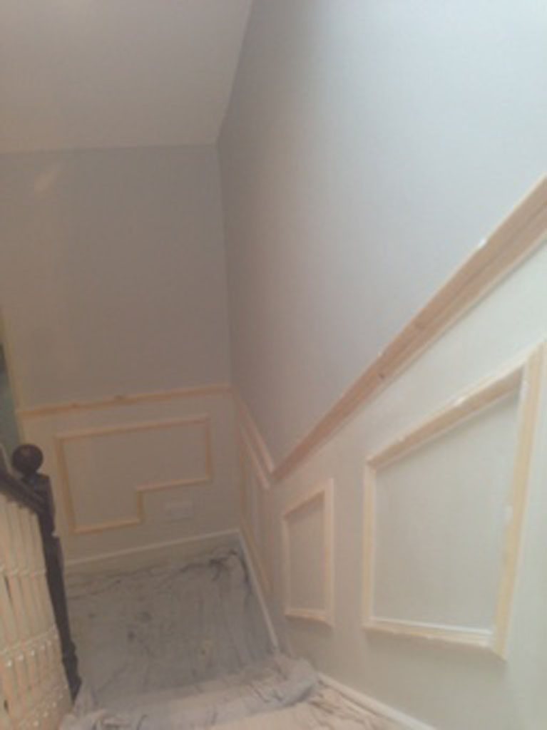 New paneling on staircase before painting