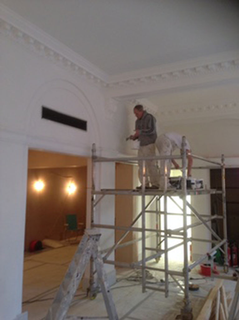 Cornice painting in progress, old bank conversion
