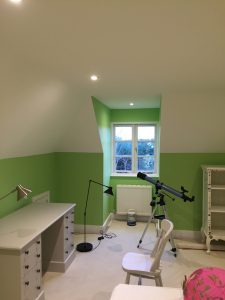 Loft conversion painting showing detail of window