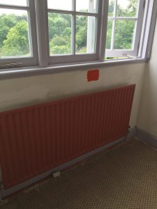Remodelling project showing radiator and wall (before)