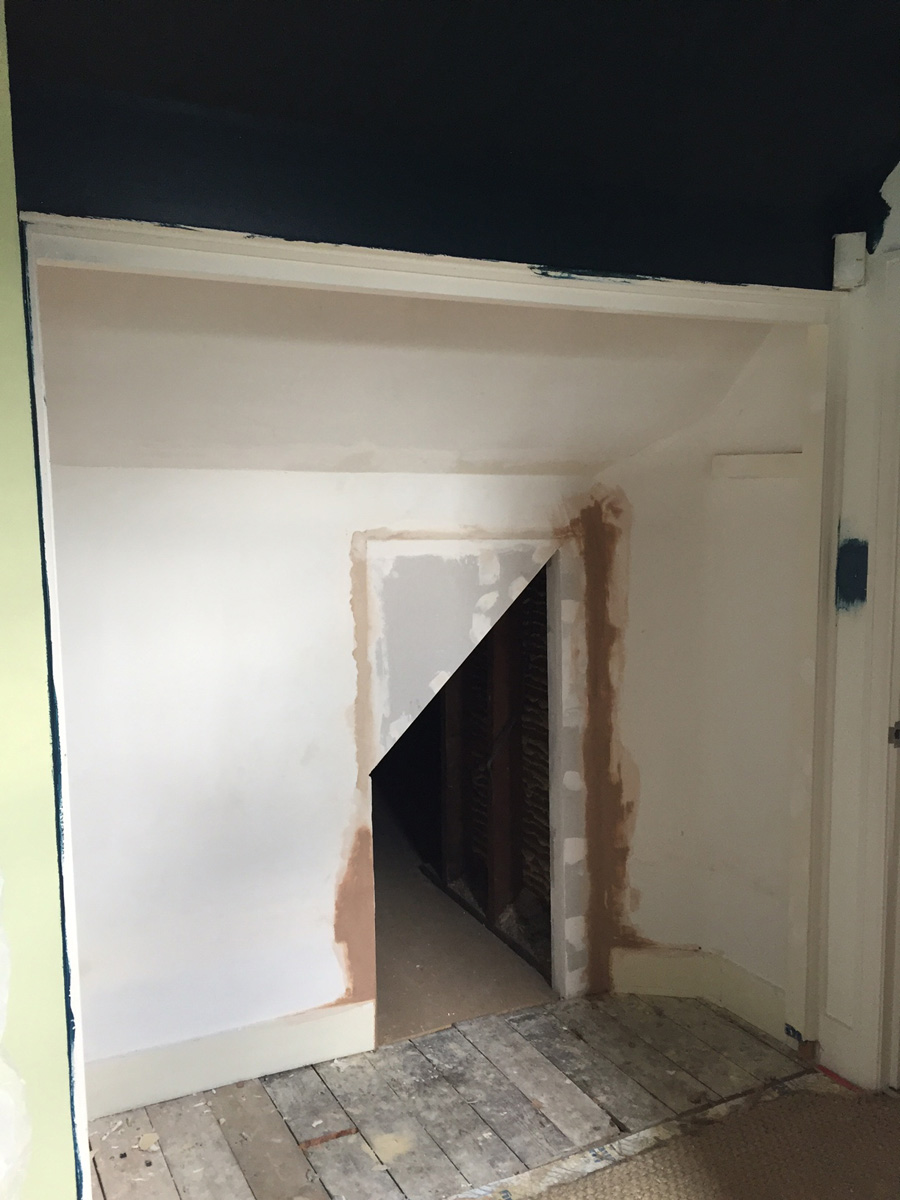 Remodelling project showing access hatch between two bedrooms (before painting)