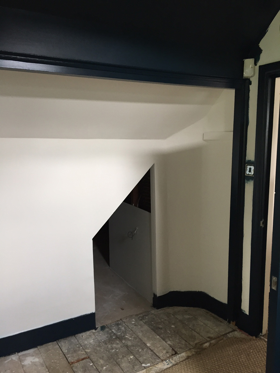 Remodelling project showing access hatch between two bedrooms (after painting)