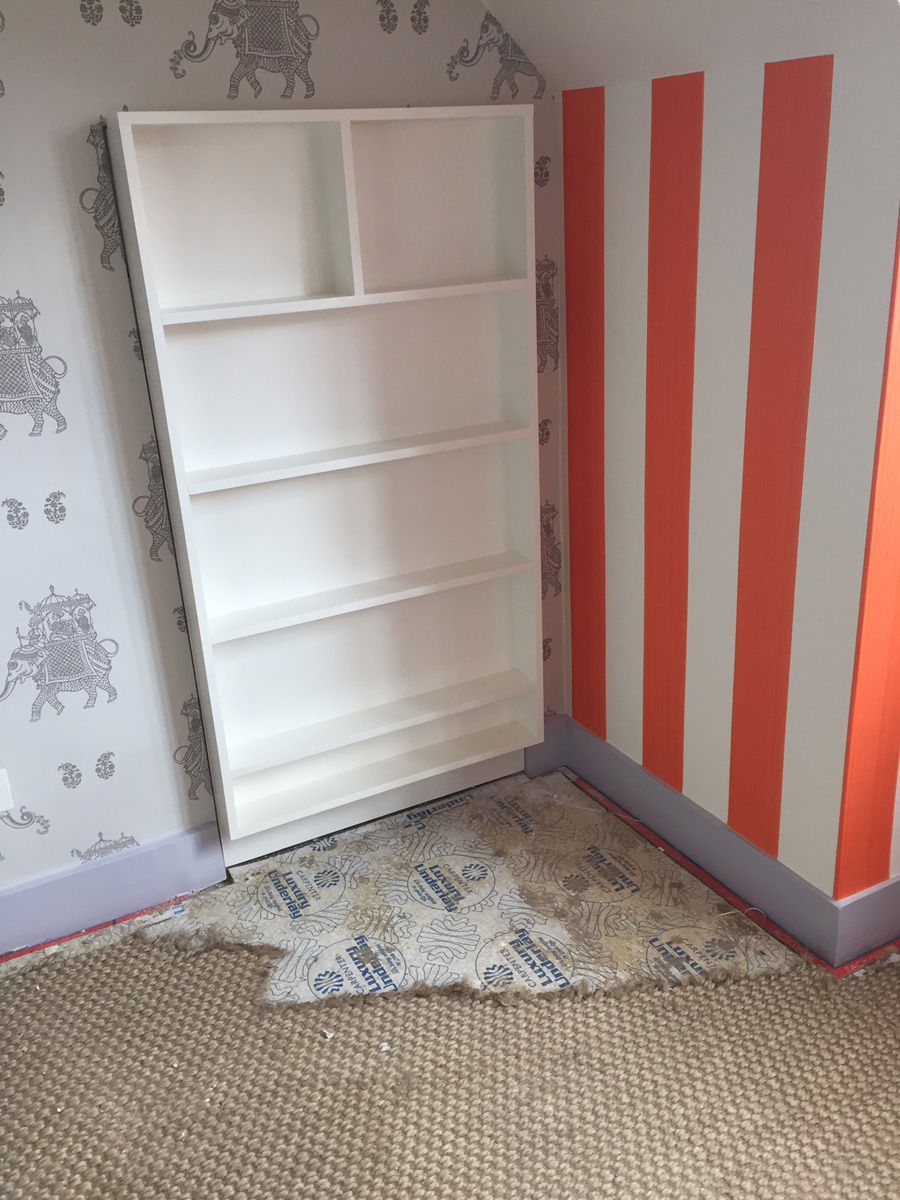 Remodelling project: bookshelf concealing hidden playroom, wallpaper, painting