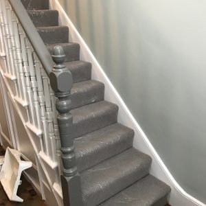 Stairway and banisters after painting (carpet protector still in place)